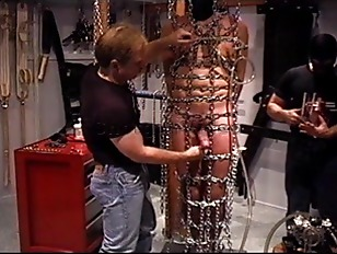 Picture CBT Orgy Bottom Suspended And Caged In Chain...