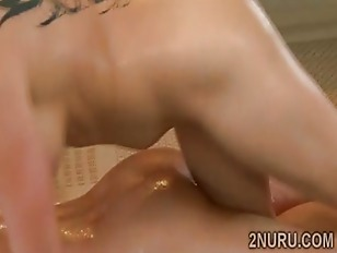 Picture Tattooed Brunette Masseuse Teases Gifted Cli...