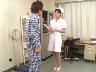 Asian nurse gives patient...