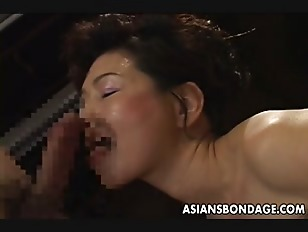 Picture Bound Japanese MILF Sucks On A Hard Cock