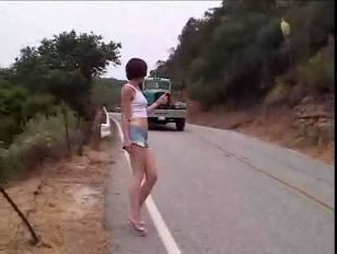 Maggie Star hitchhiking