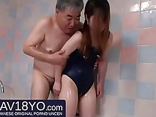 Old man fucks a young Japanese woman in the bathroom