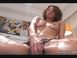 Oiled up brunette slut foot fucks a hot cock