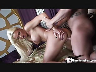 Cute blonde enjoys a...