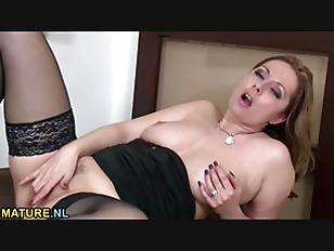 Picture Brunette MILF Masturbating On The Pouffe