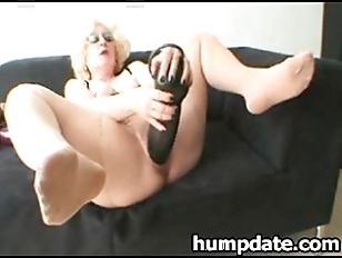 Babe Inserts Huge Dildos...