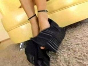 Brunette Pleasures Herself With...