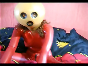 Girl In Red Latex...