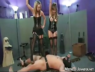 Two Dominatrixes Trample And...