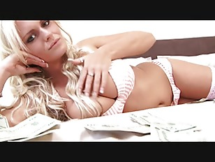 Sexy stripper lies naked on her bed covered with money
