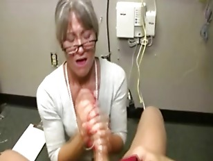 Horny Granny Tugging Cock...