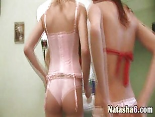 Two Lesbians Playing With...