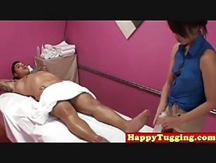 Asian Masseuse Massages Client...