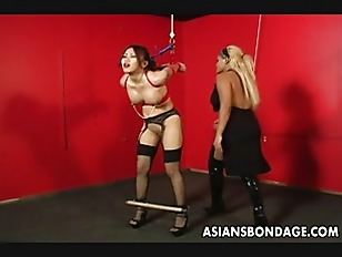 Bound Asian Lass Is...