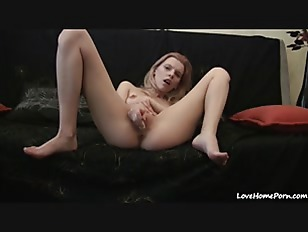 Poking the shaved pussy with a white dildo