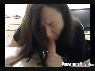 Mature brunette whore gives blowjob