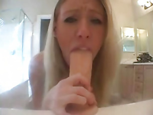 Picture Cute Blonde Practices Sucking On Dildo
